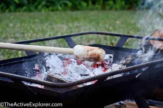 Roasting the bread over coals