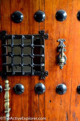Heavy wood door leading to La Quinta Luna